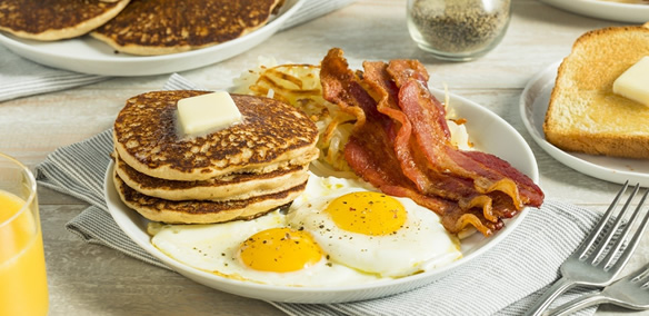 Pancakes with eggs and bacon for brunch catering east bay